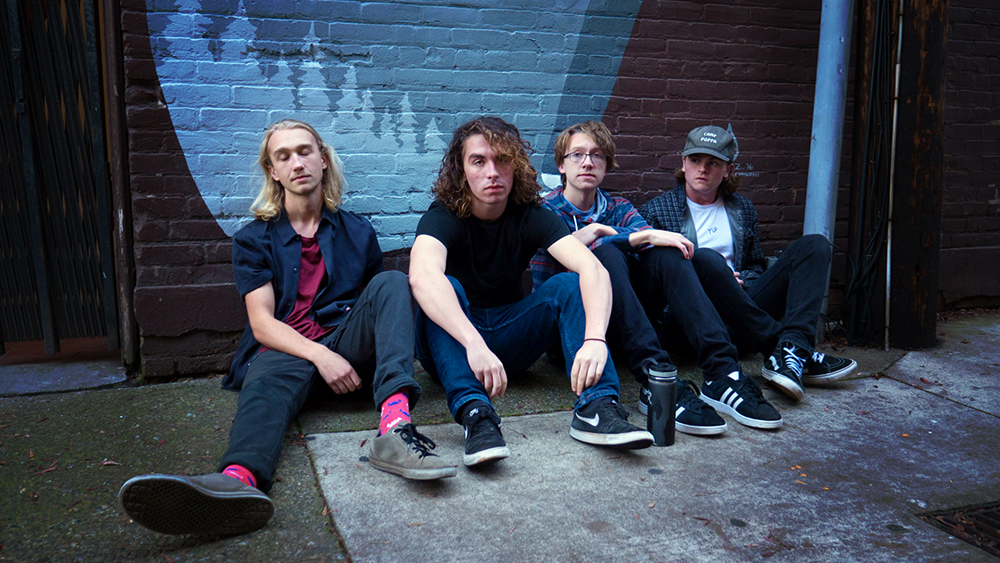 The Macks rock band chilling on streets of Corvallis after release of Happy Camper EP